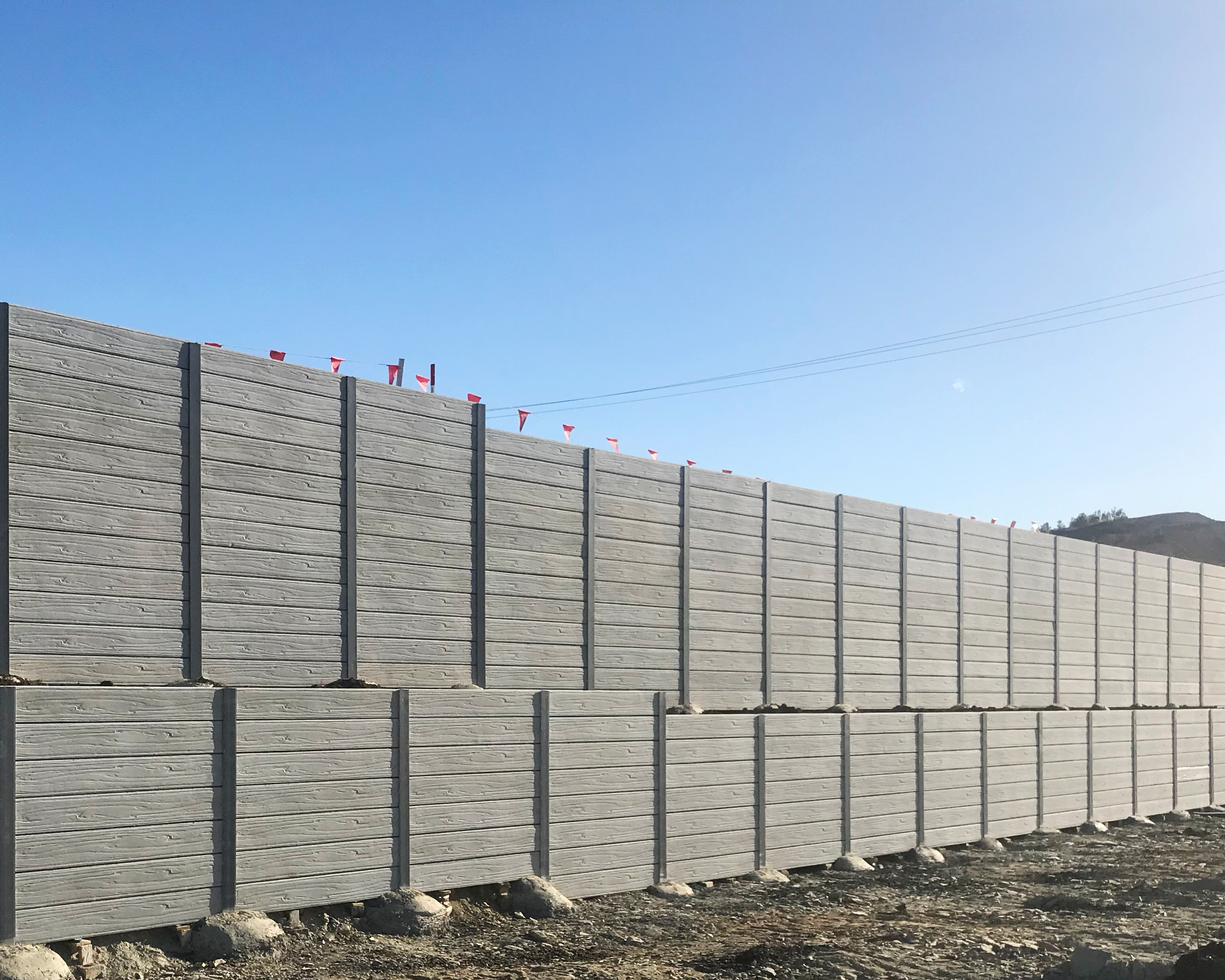 concrete sleeper retaining wall engineered by urban retaining walls