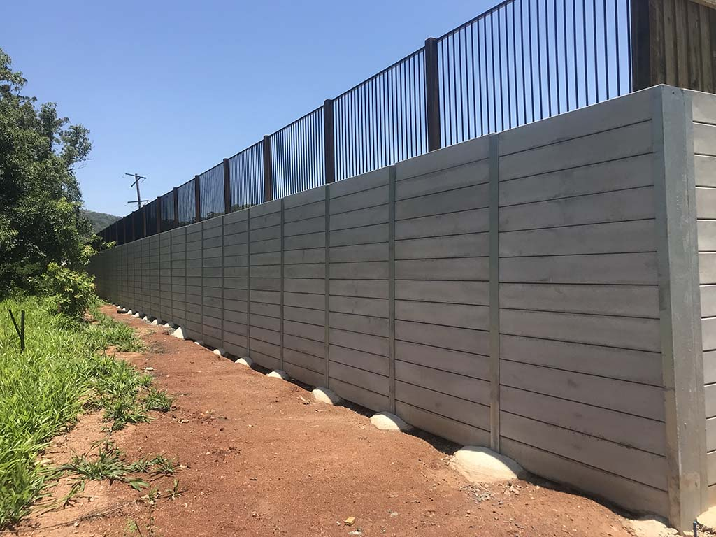 Yandina project concrete retaining wall constructed by Urban Retaining Walls with fence on top